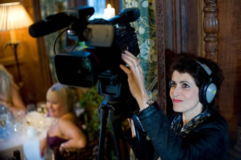 Carol with a Canon XF305 filming a wedding at Hever Castle. Photograph by Kenny Hickey