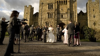 Carol Navis from Cut Above Productions filming a wedding outside Hever Castle