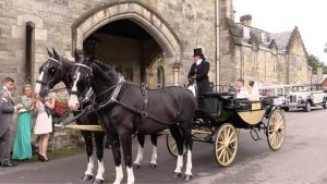 Graham and Sophie's Ashdown Park wedding in a horse drawn carriage