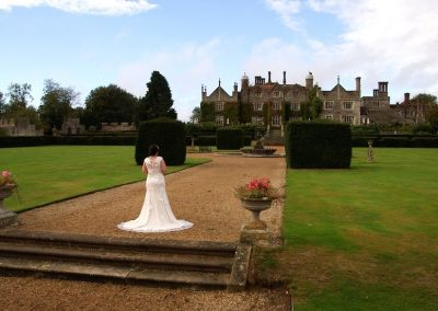 Aimee's dress on the steps of Eastwell Manor