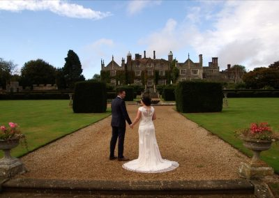 Aimee and Mike face the front on the steps of Eastwell Manor