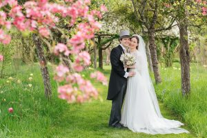 Emma and Tom take a stroll through the blossom at Hever Church