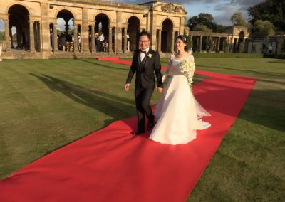 Yang and Chengyang on Hever Castle's red carpet